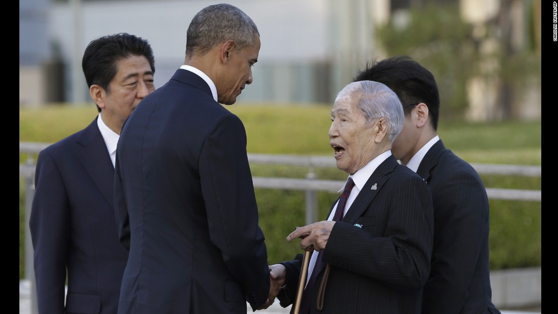 President Obama, center, accompanied by Japanese Prime Minister Shinzo Abe, left, shakes hands and talks with Sunao Tsuboi, a survivor of the 1945 atomic bombing and chairman of the Hiroshima Prefectural Confederation of A-bomb Sufferers Organization (HPCASO), at Hiroshima Peace Memorial Park in Hiroshima, western Japan.