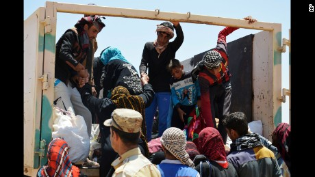 Civilians from Falluja, Iraq, flee their homes as fighting between Iraqi security forces and ISIS continues on Thursday, May 26.