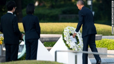 US president Barack Obama lays a wreath at the Hiroshima Peace Memorial park cenotaph in Hiroshima on May 27, 2016. Obama became the first sitting US leader to visit the site that ushered in the age of nuclear conflict.  / AFP / JOHANNES EISELE        (Photo credit should read JOHANNES EISELE/AFP/Getty Images)