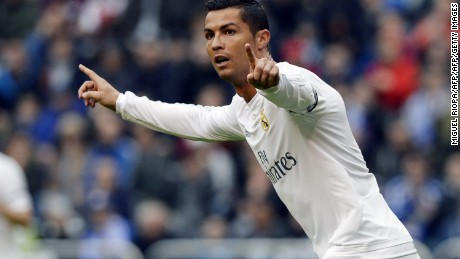 Real Madrid's Portuguese forward Cristiano Ronaldo celebrates after scoring a goal during the Spanish league football match RC Deportivo de la Coruna vs Real Madrid at the Riazor stadium in Coruna on May 14, 2016. / AFP / MIGUEL RIOPA        (Photo credit should read MIGUEL RIOPA/AFP/Getty Images)