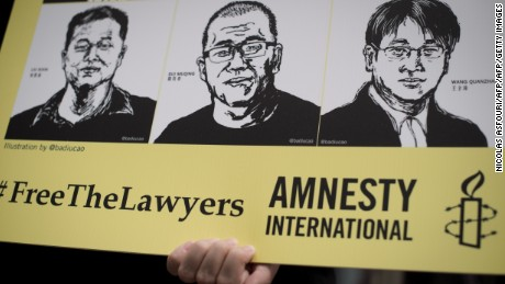 Activists protest outside the Chinese embassy in Bangkok on August 6, 2015. Amnesty International staged a protest outside the Chinese embassy to demand the release of over 200 human rights lawyers and activists in China. AFP PHOTO / Nicolas ASFOURI        (Photo credit should read NICOLAS ASFOURI/AFP/Getty Images)