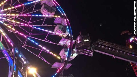 Firefighters rescued stranded people on a Ferris wheel