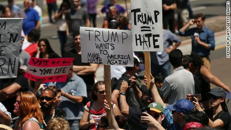 Demonstrators protest outside of an arena where the presumptive Republican presidential candidate Donald Trump is holding a rally in San Diego on May 27, 2016.