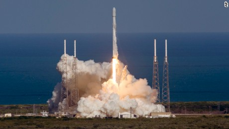 SpaceX, an unmanned Falcon rocket, lifts off from from Cape Canaveral Air Force Station. It's the third successful booster landing at sea for the company.