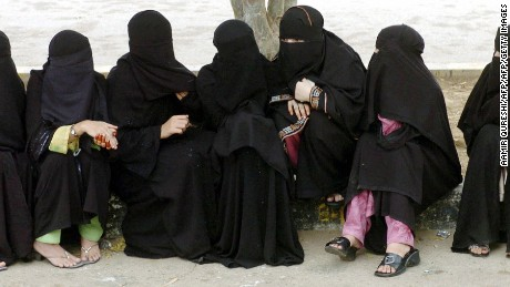 KARACHI, PAKISTAN:  Pakistani Muslim women wait before casting their vote outside a polling station in Karachi, 18 August 2005.  Pakistani voters went to the polls for local elections that are being seen as a test of President Pervez Musharraf's fight against Islamic hardliners and of his commitment to women's rights.                 AFP PHOTO/Aamir QURESHI  (Photo credit should read AAMIR QURESHI/AFP/Getty Images)