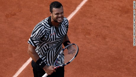 France's Jo-Wilfried Tsonga reacts during his men's third round match against Latvia's Ernests Gulbis at the Roland Garros 2016 French Tennis Open in Paris on May 28, 2016. / AFP / Thomas SAMSON        (Photo credit should read THOMAS SAMSON/AFP/Getty Images)