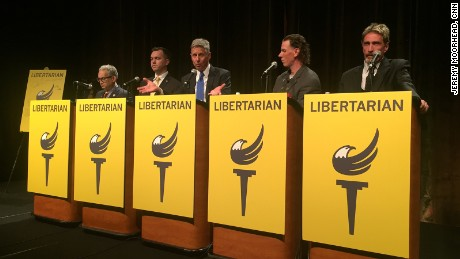 Marc Feldman (left), Austin Petersen, Gary Johnson, Darryl Perry and John McAfee participate in the Libertarian Party's final presidential debate for the 2016 nomination race on May 28.