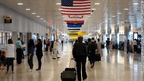 People walk through John F. Kennedy (JFK) Airport on May 24, 2016 in New York.