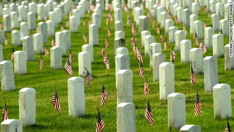 American flags adorn each grave in Arlington National Cemetary in honor of Memorial Day May 27, 2002 in Arlington, VA.