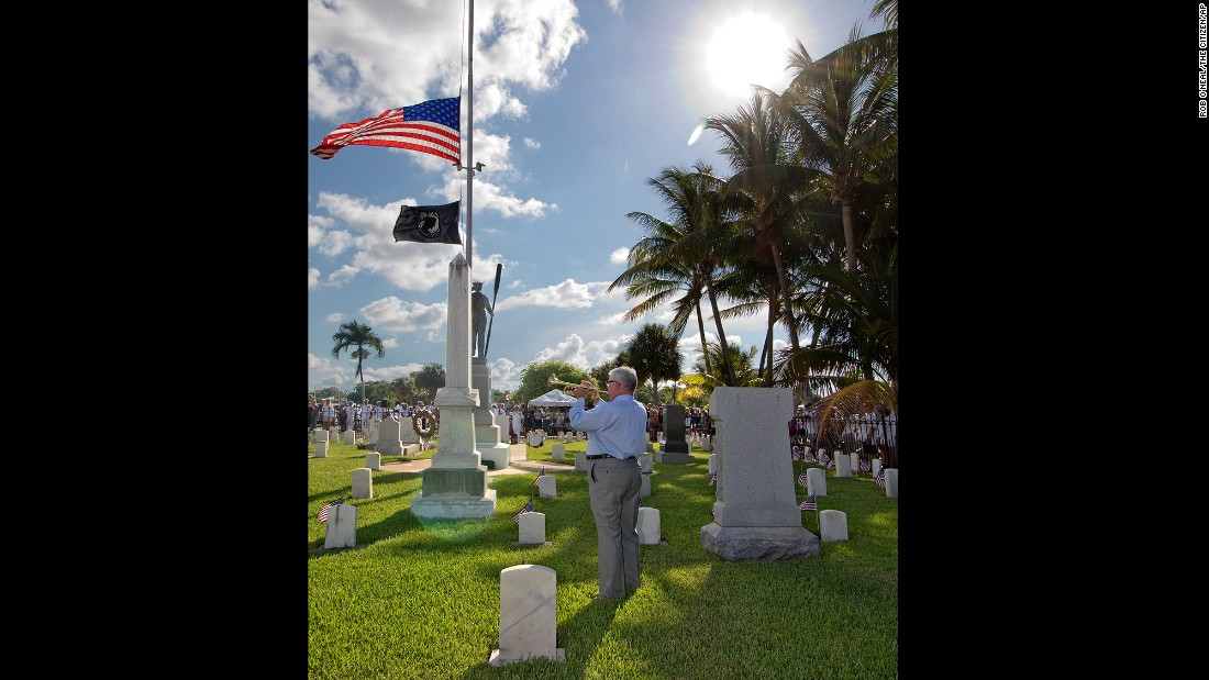 Former music teacher Jim Doepke plays taps at the conclusion of a Memorial Day ceremony in Key West, Florida.