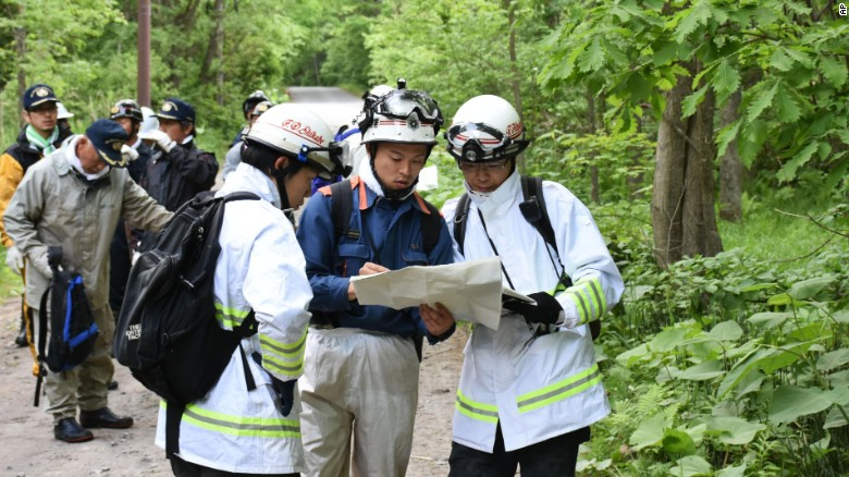 Rescuers search for a 7-year-old boy missing in a Japanese forest in Nanae town, Hokkaido, Monday, May 30.