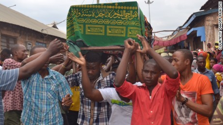 The coffin of Sergeant Juma Zahoro, who died at El Adde, is carried to his funeral in Mombasa.