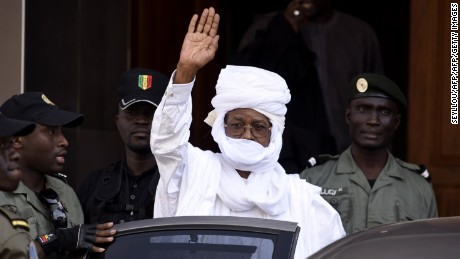 Former Chadian dictator Hissene Habre leaves a Dakar courthouse after an identity hearing on June 3, 2015.