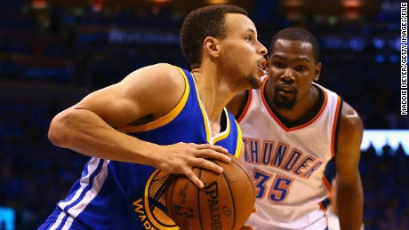 OKLAHOMA CITY, OK - MAY 28:  Stephen Curry #30 of the Golden State Warriors drives against Kevin Durant #35 of the Oklahoma City Thunder during the fourth quarter in game six of the Western Conference Finals during the 2016 NBA Playoffs at Chesapeake Energy Arena on May 28, 2016 in Oklahoma City, Oklahoma. NOTE TO USER: User expressly acknowledges and agrees that, by downloading and or using this photograph, User is consenting to the terms and conditions of the Getty Images License Agreement.  (Photo by Maddie Meyer/Getty Images)