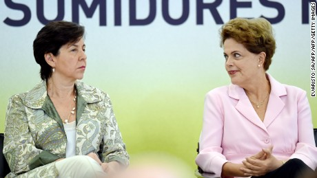 Brazilian President Dilma Rousseff (R) and her Minister of Social Development, Tereza Campello, talk during the launching ceremony of the Agricultural Protection National Plan, at Planalto Palace in Brasilia, on May 6, 2015. Rousseff's leftist government has embarked on a course of modest austerity in an attempt to refloat the economy but has struggled to obtain the support of several allies in its governing coalition. Brazil's industrial production has dropped 4.7 percent over 12 months after slipping in March by 0.8 percent amid a sharp downturn in the world's seventh-largest economy, official figures showed Wednesday.   AFP PHOTO / EVARISTO SA        (Photo credit should read EVARISTO SA/AFP/Getty Images)