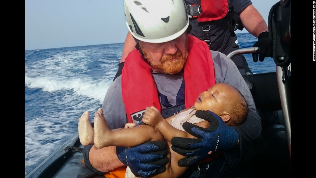 A member of the humanitarian organization Sea-Watch holds a migrant baby who drowned following the capsizing of a boat off Libya on May 27. In 2016 alone, more than 3,000 people have died or gone missing in the Mediterranean Sea, according to the International Organization for Migration.