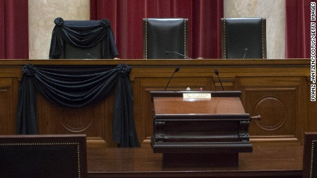 WASHINGTON, DC - FEBRUARY 15: In this handout from the the Supreme Court of the United States, U.S. Supreme Court Associate Justice Antonin Scalia's Bench Chair and the Bench in front of his seat draped in black after his death on February 15, 2016 in Washington, DC. Scalia died February 13, reportedly of natural causes, at a resort in Texas.  (Photograph by Franz Jantzen/Collection of the Supreme Court of the United States via Getty Images)