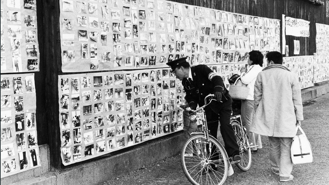 """I had big open-air exhibition with a sign that said, 'Are you in these photos? If you find yourself, please take it for free on the last day.' It developed into a kind of neighborhood festival along the Kamo River. Many people came: teachers, policemen, old women and children."""