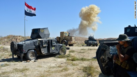 Smoke rises as Iraqi counter-terrorism forces face off with ISIS militants on the southern edge of Falluja, Iraq, on Tuesday, May 31.