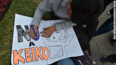 """Thousands of activists gather to rally and march in Lima on May 31, 2016, opposing the candidacy of  Keiko Fujimori, of  the Fuerza Popular (Popular Strength) party, to the Peruvian presidency in the upcoming June 5 runoff election. Fujimori, daughter of former President Alberto Fujimori (1990-2000), imprisoned on corruption and crimes against humanity charges, faces Pedro Pablo Kuczynski, candidate of the """"Peruanos por el Kambio"""" (Peruvians for Change) party. Corruption allegations to members of the Fujimori inner circle taint Fujimoris campaign who continues to lead the polls with more than 45 percent of the voting intention. / AFP / CRIS BOURONCLE        (Photo credit should read CRIS BOURONCLE/AFP/Getty Images)"""