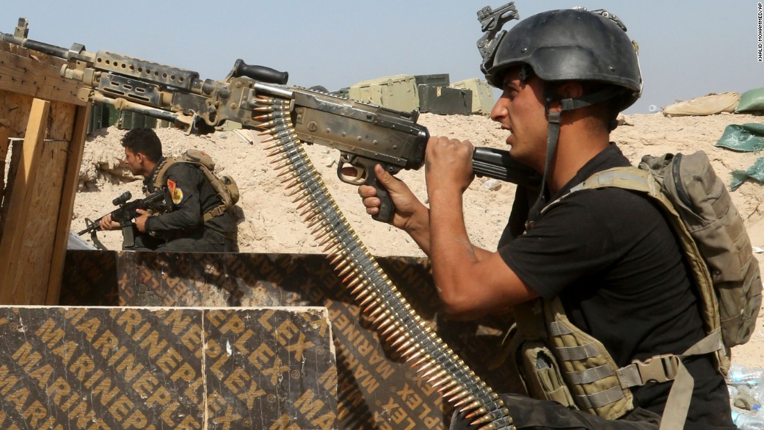 Iraqi counterterrorism forces face off with ISIS militants in Falluja's Nuaimiya neighborhood on Wednesday, June 1.