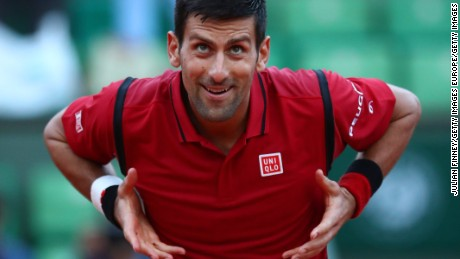 PARIS, FRANCE - MAY 28:  Novak Djokovic of Serbia celebrates victory during the Men's Singles third round match against Aljaz Bedene of Great Britain on day seven of the 2016 French Open at Roland Garros on May 28, 2016 in Paris, France.  (Photo by Julian Finney/Getty Images)