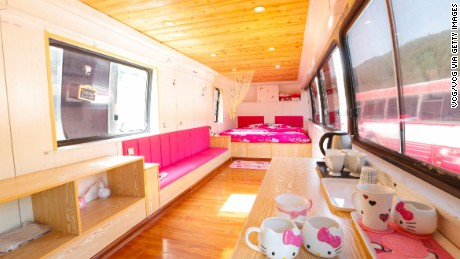 """A Hello Kitty themed recreational vehicle at a resort on May 29, 2016 in Taiyuan, Shanxi Province of China. A resort spent more than 100,000 yuan (about 15,200 USD) to reconstruct decades of scrapped buses into different themed recreational vehicles with international standards. Kitchens, TVs, air conditions and bathrooms were available in the vehicles whose minimum daily rent was less than 200 yuan (about 30.4 USD) to attract the young people for camping items. Currently, the resort staff were stepping up reconstruction of the rest uncompleted """"recreational vehicles"""" to meet the growing demand from customers."""