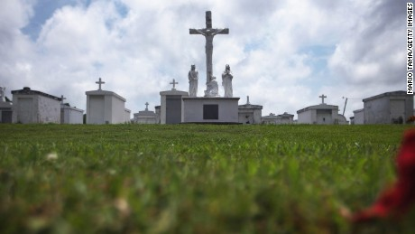 PORT SULPHUR, LA - MAY 16, 2015: The cemetery outside Saint Patrick's Church stands in Plaquemines Parish on May 16, 2015 in Port Sulphur, Louisiana. The tenth anniversary of Hurricane Katrina, which killed at least 1836 and is considered the costliest natural disaster in U.S. history, is August 29. (Photo by Mario Tama/Getty Images)