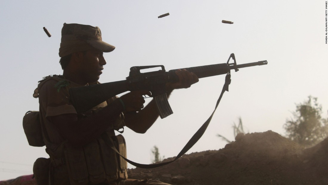 A member of pro-government forces fires at a front line in the Albu Huwa area south of Falluja on June 1.