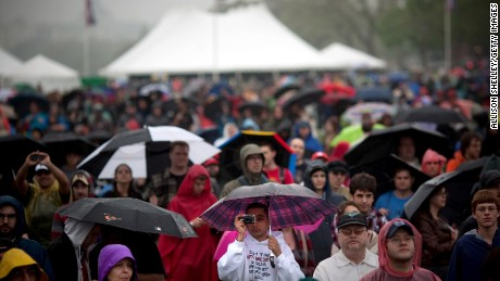 """Attendees listen to speakers during the National Atheist Organization's """"Reason Rally"""" March 24, 2012 on the National Mall in Washington, DC."""
