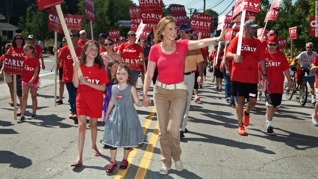 Former Hewlett-Packard CEO Carly Fiorina marches with her family in the Labor Day parade in 2015 in Milford, New Hampshire. Fiorina unsuccessfully sought the GOP presidential nomination in 2016 and then briefly joined Sen. Ted Cruz as his running mate before he suspended his campaign.
