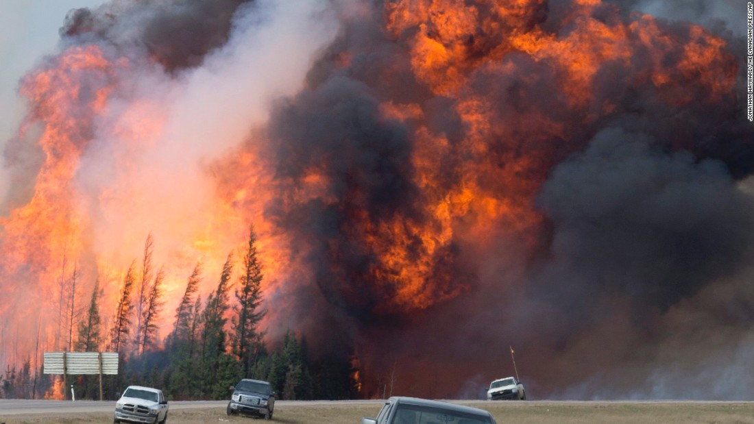 """A wildfire rips through the forest near Fort McMurray, Alberta, on Saturday, May 7. More than 88,000 people <a href=""""http://www.cnn.com/2016/05/05/world/gallery/canada-wildfire-fort-mcmurray/index.html"""" target=""""_blank"""">were forced to flee their homes.</a>"""