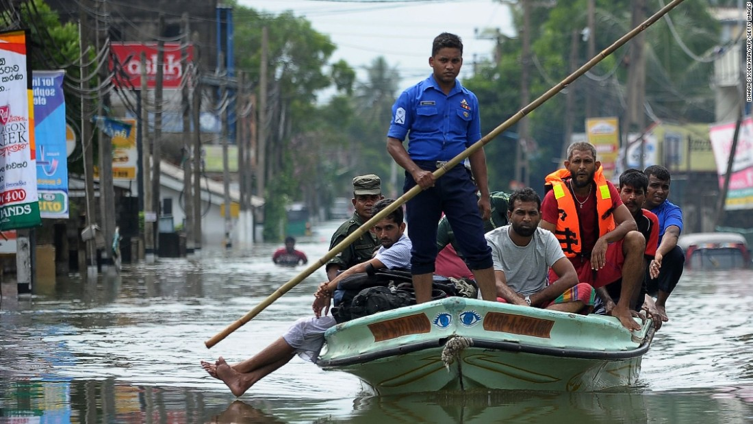 """Sri Lankan military personnel evacuate homes following flooding in the Kolonnawa suburb of Colombo on Friday, May 20. <a href=""""http://www.cnn.com/2016/05/22/asia/sri-lanka-flooding-deaths/index.html"""" target=""""_blank"""">At least 100 people died and thousands were displaced by flooding in the country.</a>"""