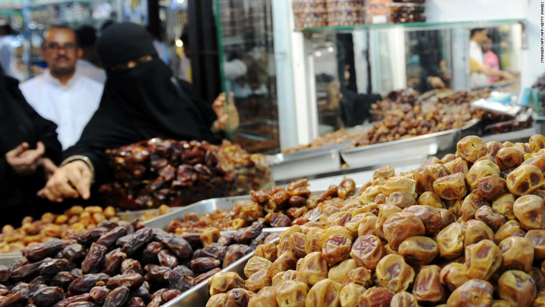 A woman shops for dates at a market in Jeddah, Saudi Arabia, on Friday, June 3.