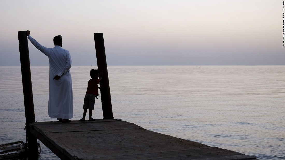 A man in Bahrain looks out for the first crescent moon that marks the start of Ramadan.