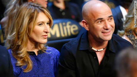 Andre Agassi with his wife and fellow multiple grand slam winner, Steffi Graf , at a boxing event in Las Vegas, Nevada last year.  (Photo: Al Bello/Getty Images)