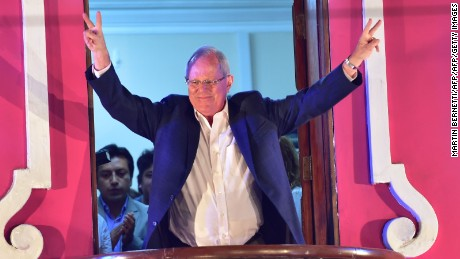 "Presidential candidate for the ""Peruanos por el Kambio"" party Pedro Pablo Kuczynski  greets supporters from a balcony after the elections in Lima on June 5, 2016. Peruvians voted Sunday in a close-fought runoff election that will decide whether Kuczynski or Keiko Fujimori, the daughter of former president Alberto Fujimori, in jail for corruption and crimes against humanity, will be their new leader. / AFP / MARTIN BERNETTI        (Photo credit should read MARTIN BERNETTI/AFP/Getty Images)"