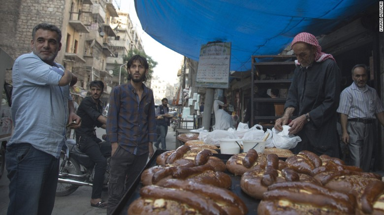 A food vendor sets up in Aleppo, Syria, on Monday, June 6. Ramadan, the most sacred month in the Muslim year, started the day before.