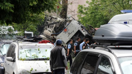 Turkish security officials work at the explosion site after a bus was struck by a bomb in Istanbul, Tuesday, June 7, 2016.