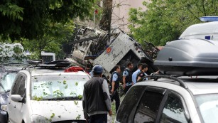 Turkish security officials work at the explosion site in a historic district of Istanbul.