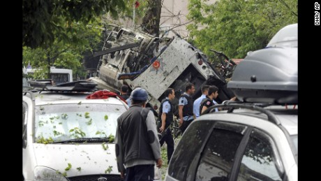 Turkish security officials and firefighters work the explosion site on June 7.