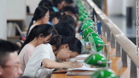 "Chinese students review textbooks or write test papers to prepare for the upcoming National College Entrance Exam, also known as gaokao, at the Shanxi Library in Taiyuan city, north China's Shanxi province, 2 June 2016.  Some nine million students are preparing for the biggest test of their life: China's annual college entrance examination. Called the gaokao, or ""high exam,"" it will take place over nine hours on June 7-8 across China. It's the culmination of years of memorization and test taking, capped off by at least 12 months of grueling preparation. With its roots in the imperial examinations that started more than 2,000 years ago, the gaokao decides what school you go to and what career you might have, says Xiong Bingqi, vice president at the 21st Century Education Research Institute in Shanghai. The gaokao is an especially high hurdle for China's more than 100 million rural students, who already receive an education of far lower quality than their urban counterparts. A quota system for allocating coveted college slots by province, which greatly favors local students, also works against rural youth who often live far from the better universities and need higher test scores than local applicants to gain admission. That means urban youth are 7 times as likely to get into a college as poor rural youth and 11 times as likely to get into an elite institution, according to economist Scott Rozelle, a Chinese education researcher at Stanford. ""The current system itself is unfair,"" Xiong says. ""Inequality is inevitable."""