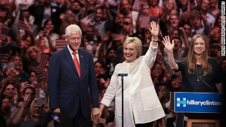 Husband and former president Bill Clinton, Democratic presidential candidate Hillary Clinton and daughter Chelsea Clinton acknowledge the crowd during a primary night rally at the Duggal Greenhouse in the Brooklyn Navy Yard, June 7, 2016 in the Brooklyn borough of New York City. Clinton  has secured enough delegates and commitments from superdelegates to become the Democratic Party's presumptive presidential nominee. She will become the first woman in U.S. history to secure the presidential nomination of one of the country's two major political parties.