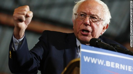 """Democratic presidential candidate Senator Bernie Sanders speaks during a rally at Barker Hangar in Santa Monica, California on June 7, 2016.  Sanders refused to concede defeat to Hillary Clinton late on June 7, vowing to """"continue the fight"""" for the Democratic nomination despite his rival declaring herself the party's flagbearer for the US presidential race. / AFP / JONATHAN ALCORN        (Photo credit should read JONATHAN ALCORN/AFP/Getty Images)"""