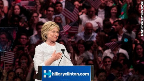 BROOKLYN, NY - JUNE 7: Democratic presidential candidate Hillary Clinton gestures to the crowd at the start of her remarks during a primary night rally at the Duggal Greenhouse in the Brooklyn Navy Yard, June 7, 2016 in the Brooklyn borough of New York City. Clinton  has secured enough delegates and commitments from superdelegates to become the Democratic Party's presumptive presidential nominee. She will become the first woman in U.S. history to secure the presidential nomination of one of the country's two major political parties. (Photo by Drew Angerer/Getty Images)