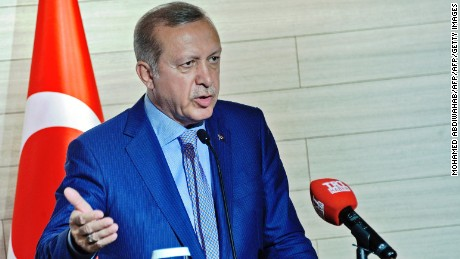 Turkey's President Recep Tayyip Erdogan speaks during a joint press conference with Somalia's President following the opening a new Turkish embassy in Mogadishu on June 3, 2016.  Turkey's President Recep Tayyip Erdogan has visited Somalia on the third and last leg of his East African tour to open Turkish sponsored projects including health facilities and the largest Turkish embassy in the world. Erdogan is the only non-African president to visit Somalia in decades. Turkey is also set to open its first military base in Africa where Turkish military officers will train Somali troops and soldiers from other African countries.  / AFP / MOHAMED ABDIWAHAB        (Photo credit should read MOHAMED ABDIWAHAB/AFP/Getty Images)
