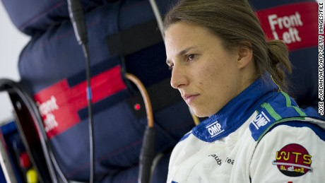 Sauber F1 Team's Swiss Formula One driver Simona de Silvestro speaks with mechanics during private test at the Ricardo Tormo racetrack in Valencia on June 26, 2014.  AFP PHOTO / JOSE JORDAN        (Photo credit should read JOSE JORDAN/AFP/Getty Images)