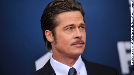 "WASHINGTON, DC - OCTOBER 15: Brad Pitt poses for photographers on the red carpet during the ""The Fury"" Washington D.C. premiere at The Newseum on October 15, 2014 in Washington, DC. (Photo by Kris Connor/Getty Images)"