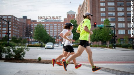Icebreakers runner Sophie Kashurba is accompanied by  guest runners Justin Mathis and Jake Landreneau as they make their way through Atlanta.