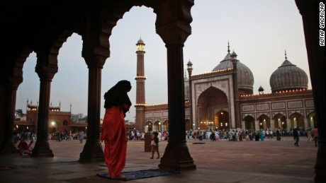 An Muslim woman prays after breaking her fast in New Delhi, India, on June 7.